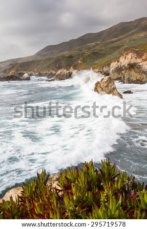 beautiful scene of the California coast on a cloudy day with its classic dramatic coastline lined with rocks and cliffs - stock photo