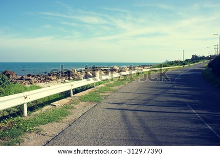 Beautiful scene of Viet Nam coastal, boundary among beach and road, wonderful landscape at Vietnamese countryside, shadow on street, this view at Lagi, Binh Thuan, VietNam