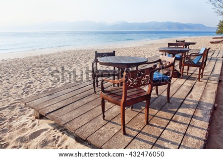 Beautiful scene on morning desert beach with white sand, clear water on on tropical island Gili near Lombok. Tropic beach with no people in lost paradise. Travel, vacations and relax in Indonesia.