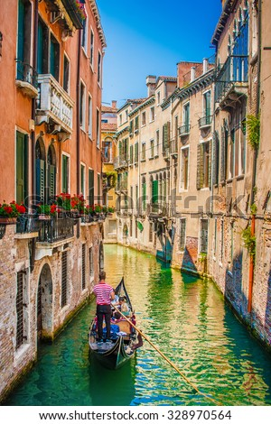 Beautiful scene with traditional gondola and canal in Venice, Italy - stock photo