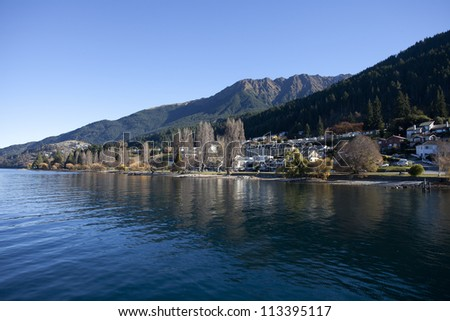 Beautiful scenery of lake Wakatipu and Southern alps mountain valleys at Queenstown New Zealand