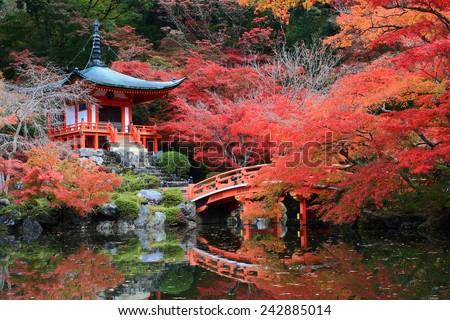 Beautiful Scenery of Red Japanese Pavilion in the Autumn time when the leaves turning their colors into red, orange and yellow - stock photo