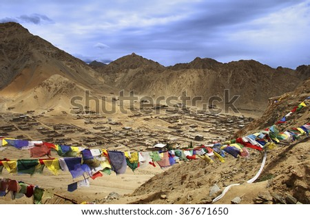 Beautiful scenery with buddhist prayer flags: Leh city - the capital of Ladakh against the background of high mountain range, view from Palace, Jammu & Kashmir, Northern India, Central Asia
