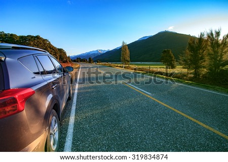 beautiful scenic of asphalt highways of mount aspiring national park south island new zealand - stock photo
