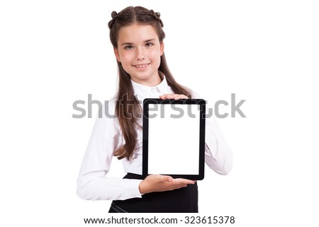Beautiful school girl in a business suit holding a vertical tablet in his hands and looking into the camera, Selective focus on the tablet - stock photo