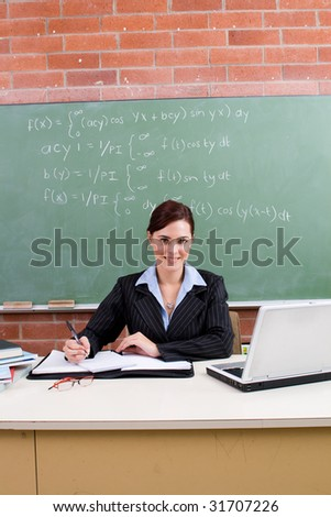 beautiful school teacher working in classroom