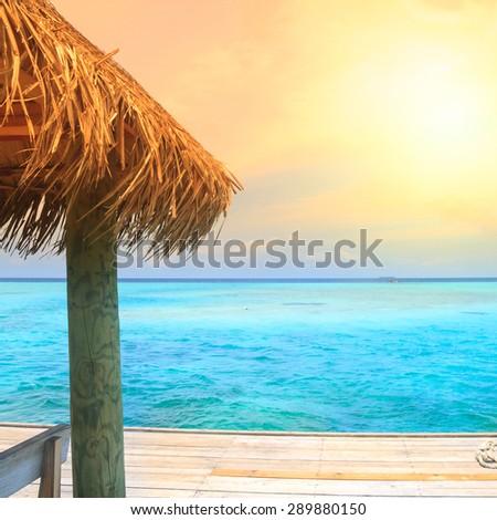 Beautiful sea and beach with jetty at Maldives - stock photo
