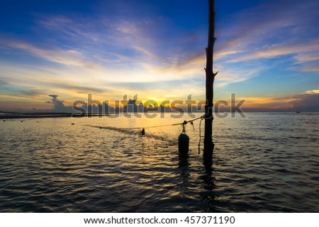 beautiful sea and sky in the morning with fishing net, thailand