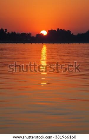 Beautiful sea and sunrise in the morning - stock photo
