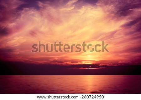 Beautiful Sea at Sunset. Majestic Sky Background. Toned and Filtered Photo. Copy Space. - stock photo