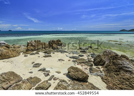 Beautiful sea blue sky at coral rock  beach Koh samui, Thailand. - stock photo