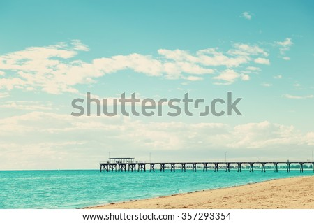 Beautiful Sea landscape with Grange Jetty Adelaide Australia and people silhouettes. Toning in retro style - stock photo