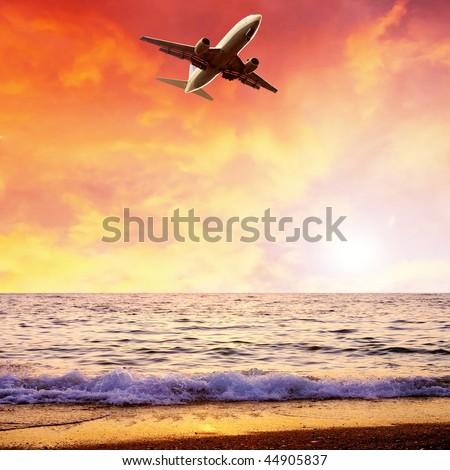 Beautiful sea nature landscape on the sunrise sky with airplane - stock photo