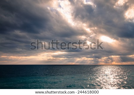 Beautiful sea panorama with empty horizon line and cloudy sky during sunset. - stock photo