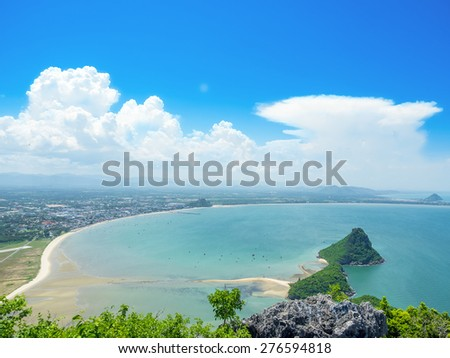 beautiful sea shore on the tropical summer time, showing blue sky, cloud and wave in the high elevated view - stock photo