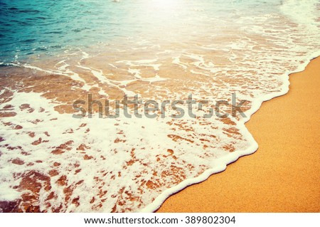 Beautiful sea summer abstract background. Golden sand beach with blue ocean waves Tourism and vacation concept. Beauty Backdrop - stock photo