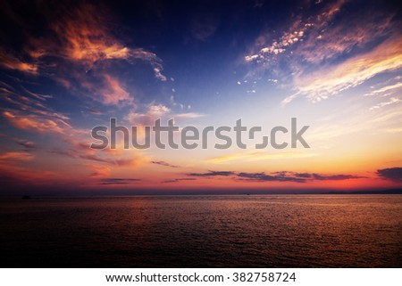 Beautiful sea sunset with pink clouds - stock photo