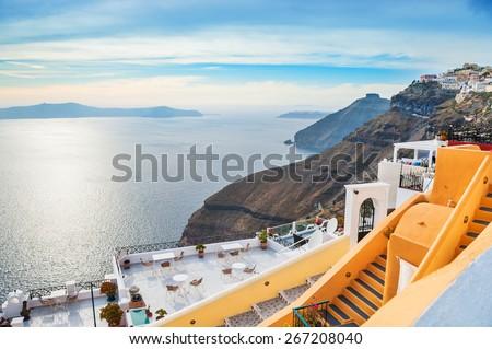 Beautiful sea view in Fira town at sunset. Santorini island, Greece.  - stock photo