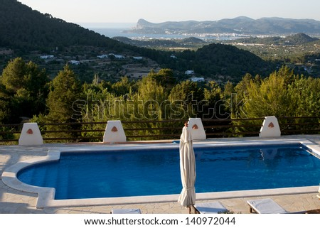 Beautiful sea view, with a pool in the foreground - stock photo