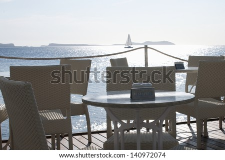 Beautiful sea view, with a sailboat on the sea - stock photo