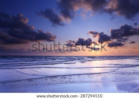 Beautiful seascape against the sunset sky background