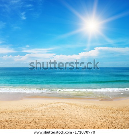 beautiful seascape and sun on blue sky background - stock photo