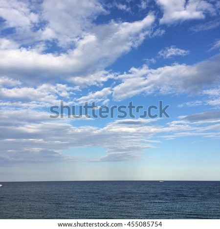 beautiful seascape, clouds and blue sky