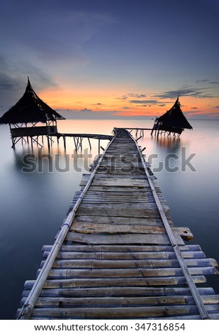 Beautiful seascape during sunset with slowshutter - stock photo
