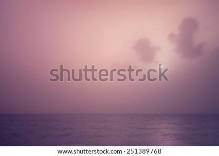 Beautiful seascape, gorgeous purple sunset over calm sea, abstract natural background, romantic evening, tranquil panorama, beauty of nature concept - stock photo