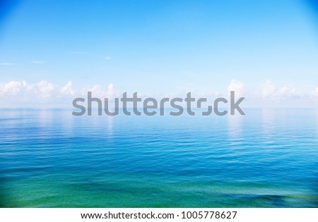 Beautiful seascape of calm water and clear sky