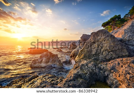 Beautiful seascape. Sea and rock at the sunset.