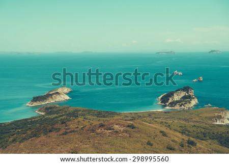 Beautiful seascape, tropical blue lagoon among islands in summer season. . Vintage toning color - stock photo
