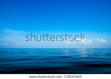 Beautiful seascape with blue sea, blue sky and cloud background - stock photo