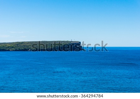 Beautiful seascape with cliff and lighthouse. Beecroft Peninsula, Jervis Bay, NSW, Australia - stock photo