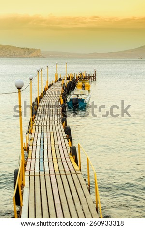 Beautiful seascape with jetty on sunset. Photo taken in Ukraine. - stock photo