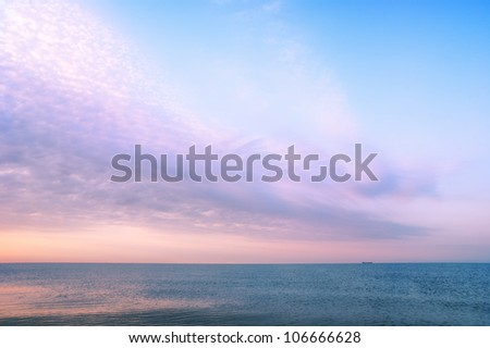 Beautiful seascape with orange warm sunrise, vacation concept