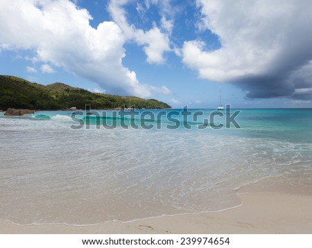beautiful seascape with two ships, waves, clear blue sea water with sea foam and big white cumulus clouds - stock photo