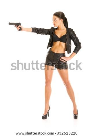 beautiful secret agent girl with handgun isolated on white - stock photo
