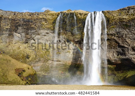 Beautiful  Seljalandsfoss waterfall with river and meadow  in Iceland