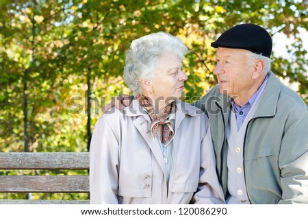 Beautiful senior couple in the park - stock photo