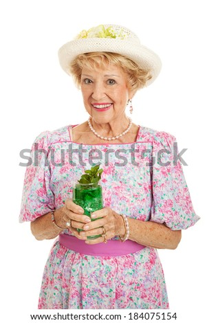 Beautiful senior Southern Belle drinking a traditional mint julep to celebrate Kentucky Derby day.  Isolated on white.   - stock photo