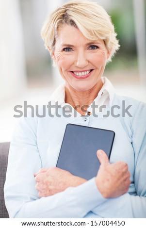 beautiful senior woman holding tablet computer - stock photo