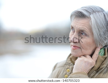 beautiful senior woman on a walk outdoors in spring