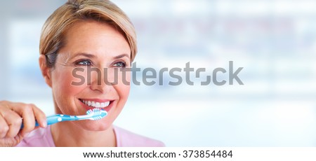 Beautiful senior woman with a toothbrush. - stock photo