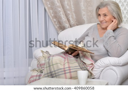 beautiful senior woman with book - stock photo