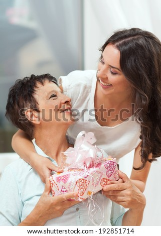 Beautiful senior woman with her daughter showing love and affection. Mother's Day - stock photo