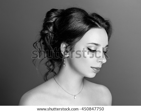 Beautiful sensual brunette with elegant hairstyle. Wedding accessories. Fashion black and white photo