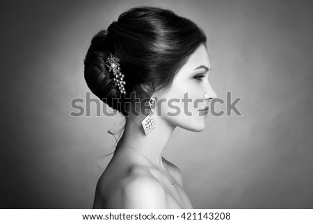 Beautiful sensual brunnete with elegant hairstyle. Wedding accessories. Fashion photo