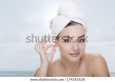 Beautiful, sensual woman face with white towel on head