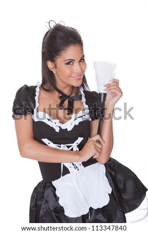 Beautiful sensual woman posing in a skimpy maids uniform with miniskirt on a white background - stock photo